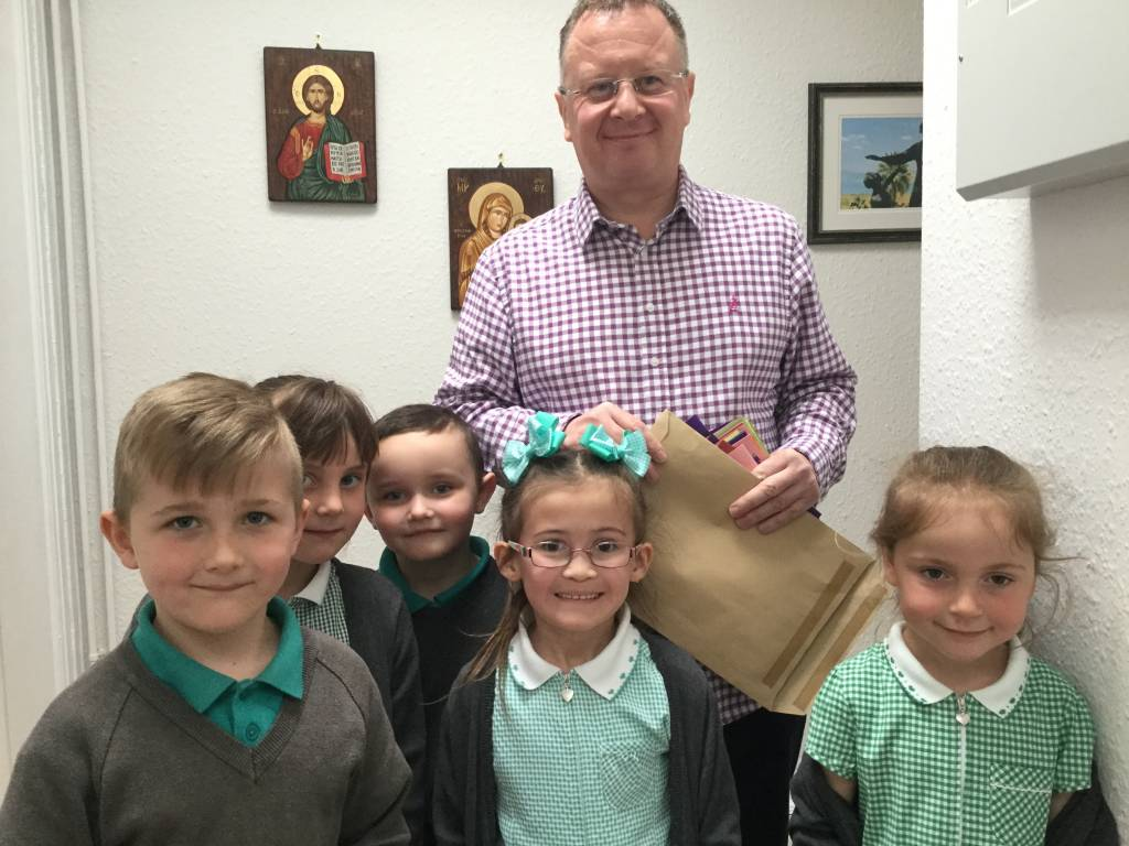 Y1 delivering Pentecost cards to Fr Mark